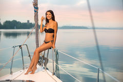 Girl sits on board and cute smiles. Stock Photography