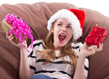 Girl sits on  chair with a gift in her hands Stock Photo