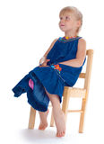 The girl sits on a chair Royalty Free Stock Photos
