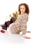 Girl sits in a cozy sweater Stock Photography