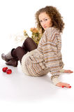 Girl sits in a cozy sweater isolated Stock Images