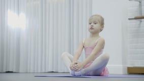071eb8624e0e The Little Girl Ballerina Stretches Stock Video - Video of dress ...