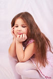 A girl sits distraught. Royalty Free Stock Photo