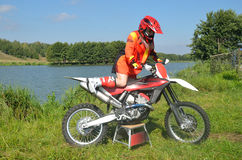 The girl sits down on sportbike MX Royalty Free Stock Photos