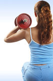Girl sits with dumbbells Stock Photography