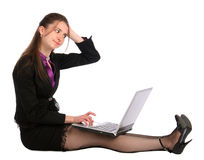 Girl sits on floor with notebook and thinks. Royalty Free Stock Photos