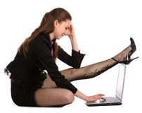 Girl sits on floor and put leg on notebook. Stock Photo
