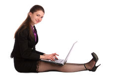 Girl sits on floor and works with notebook. Stock Photography
