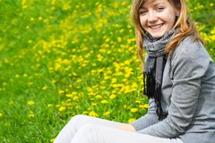 The girl sits on a grass Royalty Free Stock Photos