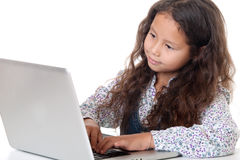 Girl sits before laptop Royalty Free Stock Photography