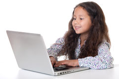Girl sits before laptop Stock Photos