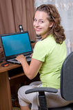 A girl sits at a laptop Royalty Free Stock Image