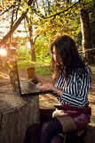 Girl sits with a laptop in the nature Stock Images