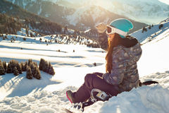 Girl sits looking into the distance mountain top at sunset Royalty Free Stock Photos