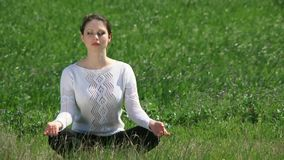 Girl Sits In The Lotus Position stock video footage