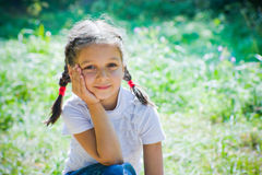 Girl sits in a park Royalty Free Stock Images