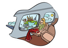 Girl sits in plane and peers into window Royalty Free Stock Images