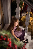 Girl sits on the porch in the new year`s eve Stock Image