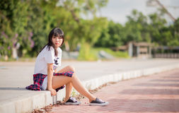 Girl sits by the road Royalty Free Stock Image