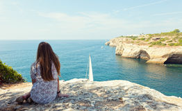 Girl sits on the rock Royalty Free Stock Images