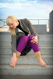 Girl sits on stair Stock Photos