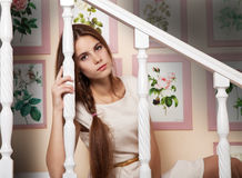 Girl sits on the stairs Royalty Free Stock Photo
