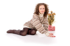 Girl sits in a sweater and boots Stock Photos