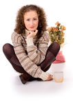 Girl sits in a sweater and boots Stock Photo