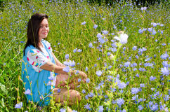 A girl sits in the tall grass Stock Image