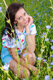 A girl sits in the tall grass Stock Photo