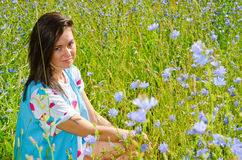 A girl sits in the tall grass Stock Photography