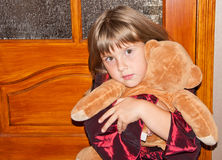 Girl sits with toy. Teen girl sits with toy bear Stock Image