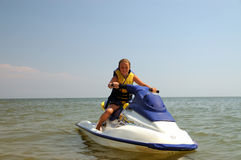 Girl sits on water bike. Stock Images