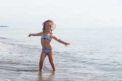 Girl sits at the water's edge Royalty Free Stock Photography