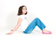 The girl sits on a white background Stock Photos