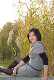 Girl sitting. This is a Chinese girl sitting behind a reed Filming in the afternoon Stock Image