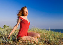 Girl sitting. On a dune Stock Photo