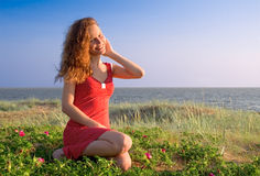 Girl sitting. On a dune Royalty Free Stock Image