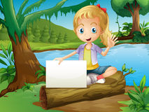 A girl sitting above a log with an empty signage Royalty Free Stock Photography