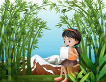 A girl sitting above a stump at the bamboo forest Royalty Free Stock Photo
