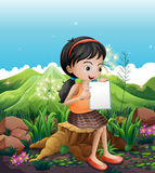 A girl sitting above a stump with a notebook Royalty Free Stock Photos