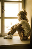 Girl sitting alone Royalty Free Stock Photography