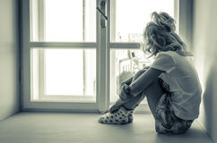 Girl sitting alone Royalty Free Stock Images