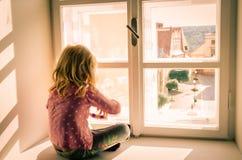 Girl sitting alone Stock Photos