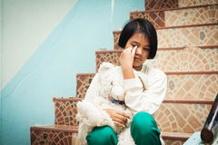 Girl sitting alone at staircase Royalty Free Stock Image