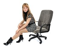 Girl sitting in an armchair Stock Images