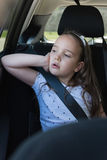 Girl sitting in back seat of car Stock Image