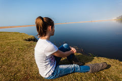 Girl Sitting Waters River Lagoon  Stock Photography