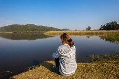 Girl Sitting River Water Lagoon Stock Images