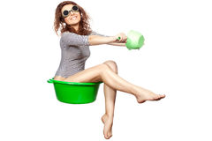 Girl sitting in a basin rides. Stock Photography